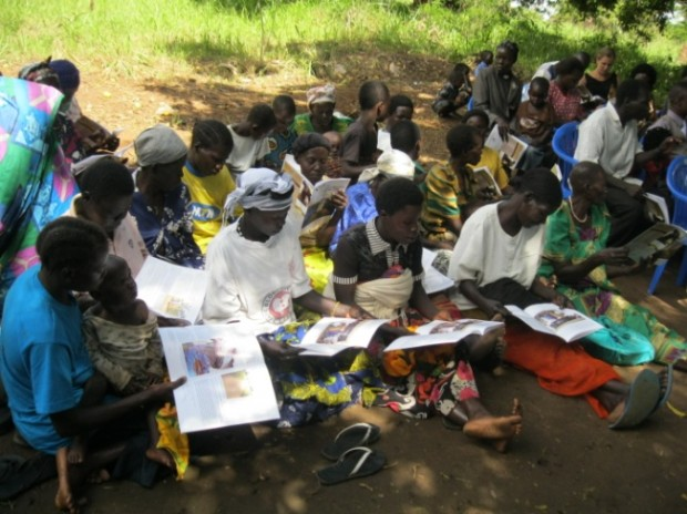 Women in Lukodi reading the new report on the Lukodi massacre
