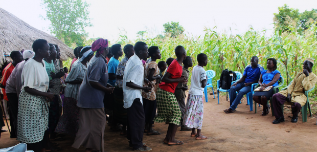 Members of Limo Can Tek victims' group in Pupwonya parish, Atiak rehearse for the Bearing Witness post-participation event on 16 October 2014. The event will be held at Atiak sub-county headquarters and will feature song, dance and theatre to highlight post-conflict transition challenges and solutions identified during the project.