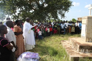 Community members participate in a memorial for the Lukodi massacre of 2004, Lukodi 19 May 2015.