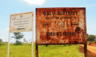 A sign for Odek Primary School in Gulu District.